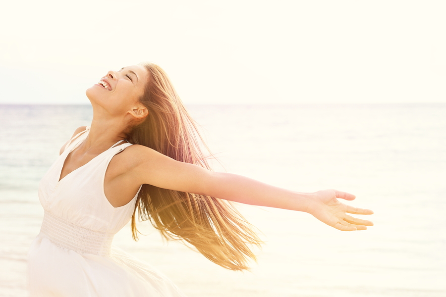Freedom woman in free happiness bliss on beach. Smiling happy mu